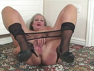 Granny April undresses together with savorily jerks off her old cunt porntv fingering mature stockings